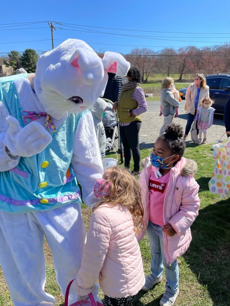 Easton Park and Rec Easter Bunny greets children.
