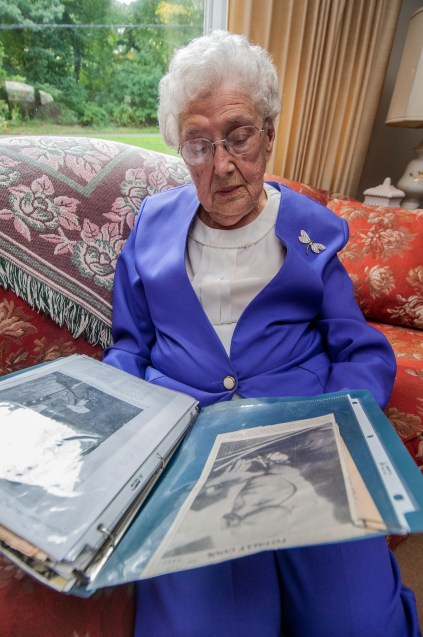 Anne Fiyalka looks through one of the many scrapbooks that chronicles her long life. — Rick Falco Photo