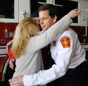 Kathy Steiger, of Easton, a victim of a crash during the March 2 nor'easter visited the Lothrop Street fire station in Easton to say thank you to the firefighters and chief Kevin Partridge, for helping her after a branch went through her right leg ,Tuesday, April 17, 2018. (Marc Vasconcellos/The Enterprise)
