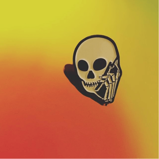 Skullphone lapel pin