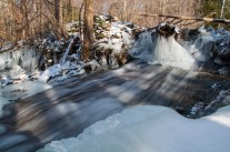 Flowing water and ice at Gillette Pond's north-end dam yesterday afternoon.