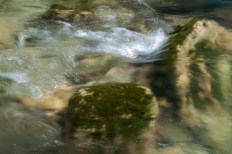 Water slides over mossy boulders in the Huntington Gorge.