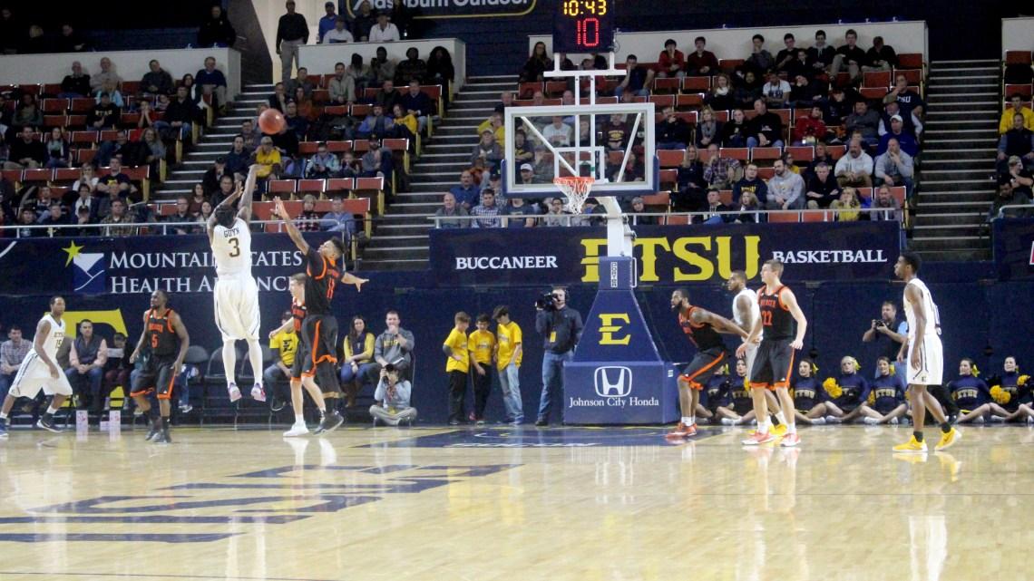 Ge'Lawn Guyn shoots a 3-pointer over Mercer guard Jordan Strawberry (Photography by Garrett Tumlin)