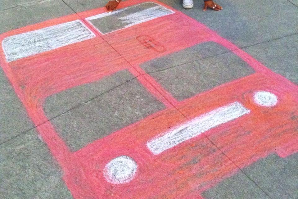 Olivia Ellis, a Roan Scholar and art student, helps prepare for the Red Bus in spring 2015