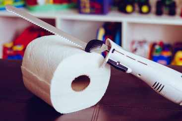 Cut the paper towel with an electric bread knife