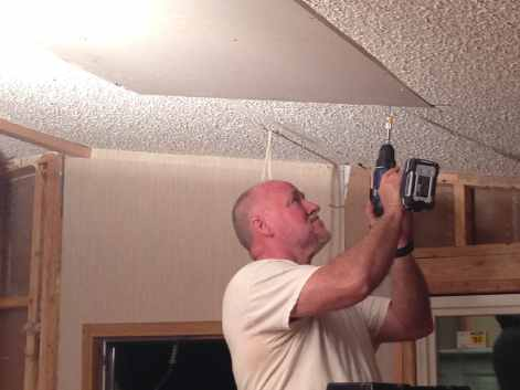 My dad covering up the hole in the ceiling
