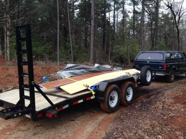 Trailer filled with carpet that we pulled out of a remodeled house.