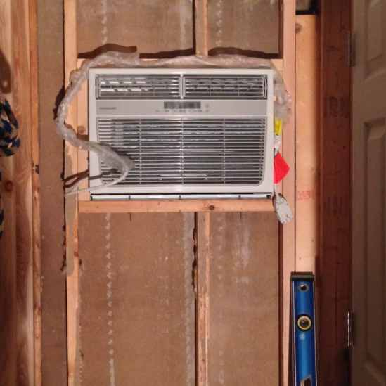 AC unit mounted in the boys bedroom wall on the homestead