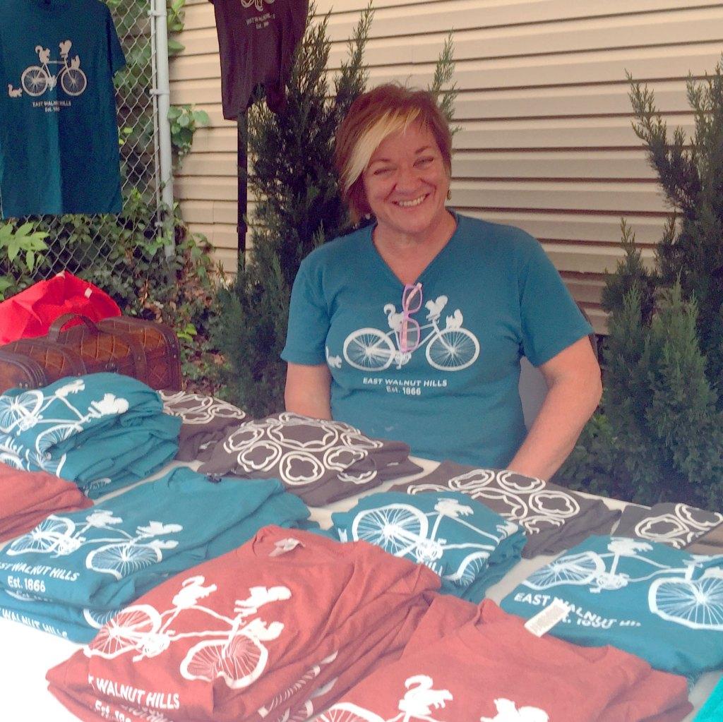 neighborhood volunteer selling East Walnut Hills t-shirts
