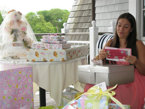 mommy opening baby shower gifts