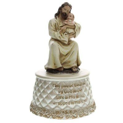 Jesus holding baby music figure