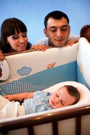 child sleeping parents watching