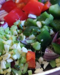 to the same oil, add chopped red onion, peppers, ginger, garlic, green chili, celery, mix