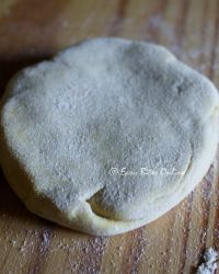 press it down gently and turn it over, roll using a rolling pin, use additional flour if needed