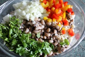 add the unmashed beans, red and yellow bell peppers, chopped onion, garlic, mint, coriander, mix