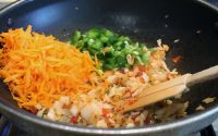add grated carrot, finely chopped green bell pepper, mix, cook until soft