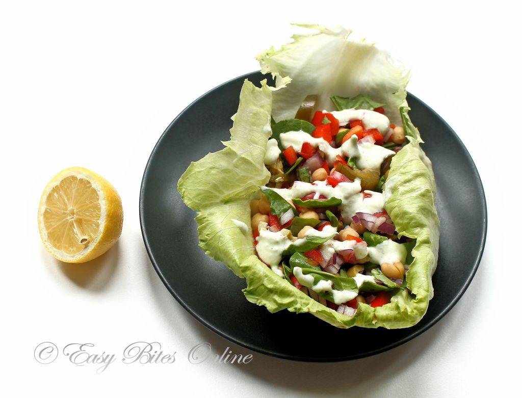place the salad over the lettuce leaf, drizzle over tzatziki sauce, serve.