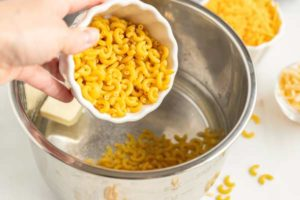 Add the macaroni, water, and butter to the Instant Pot.