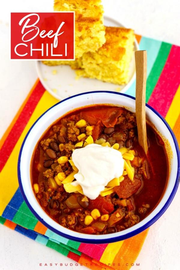 Beef Chili in a bowl with text overlay for Pinterest.