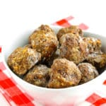 A bowl of homemade frozen meatballs.