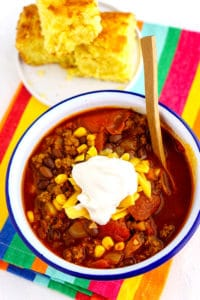 Overhead picture of beef chili in a white bowl.