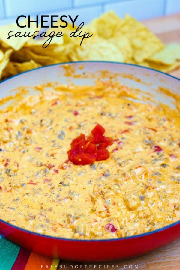 Finished Cheesy Sausage Dip recipe with chips and text overlay for Pinterest.