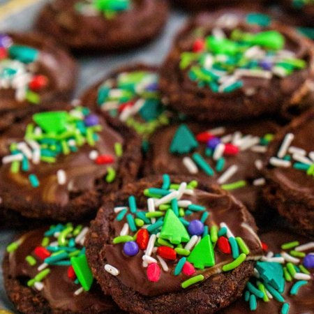 Brownie Cookies stacked on top of each other on a plate.