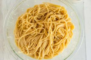 Toss the cooked spaghetti in with egg, butter, and Parmesan cheese.