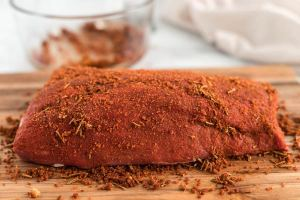 Rub the beef on all sides with the rub and let it sit at room temperature for 20-30 minutes.