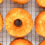 Take the donuts out of the oil and place them on a wire rack.