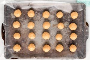 Freeze the peanut butter bon bons until solid before dipping in chocolate.