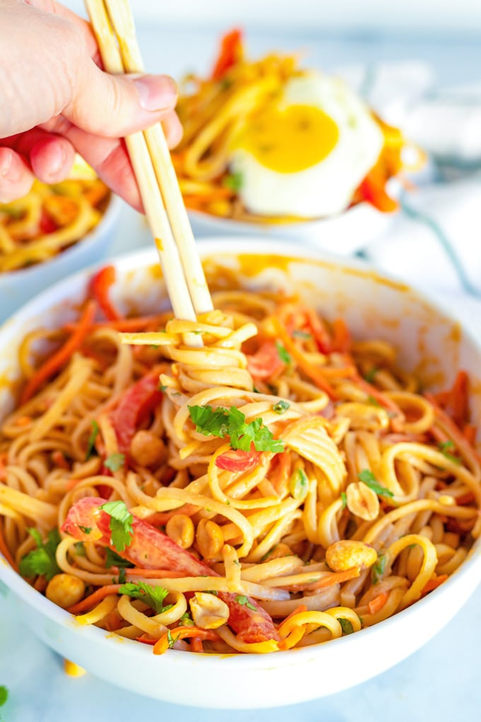 Chopsticks twirling peanut noodles.