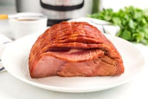 Place the cooked ham on a platter.
