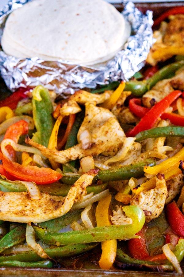 Close up picture of sheet pan chicken fajitas.