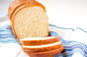 Slices of homemade white bread on a dish towel.