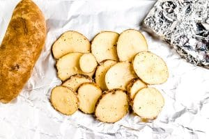 Divide the potato mixture evenly among the foil pieces.