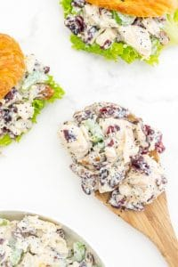An overhead picture of chicken salad on a wooden spoon.