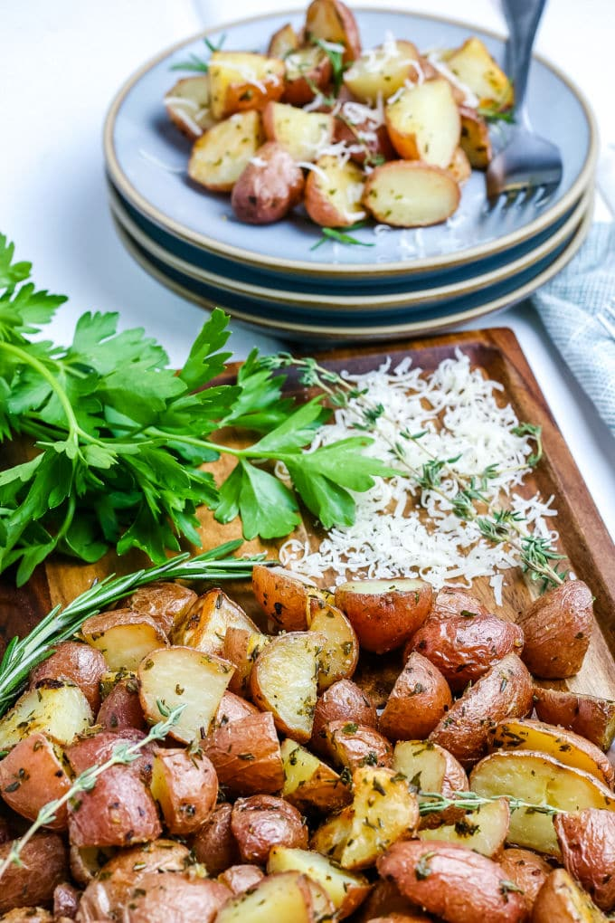 The oven roasted red potatoes on a dinner plate.