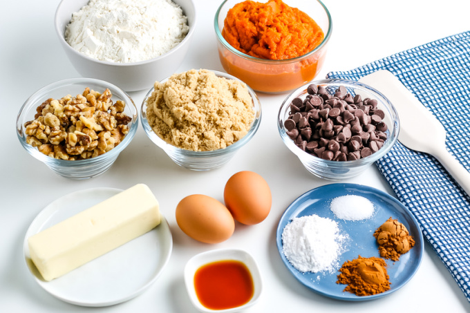 All of the ingredients needed to make soft pumpkin chocolate chip cookies.