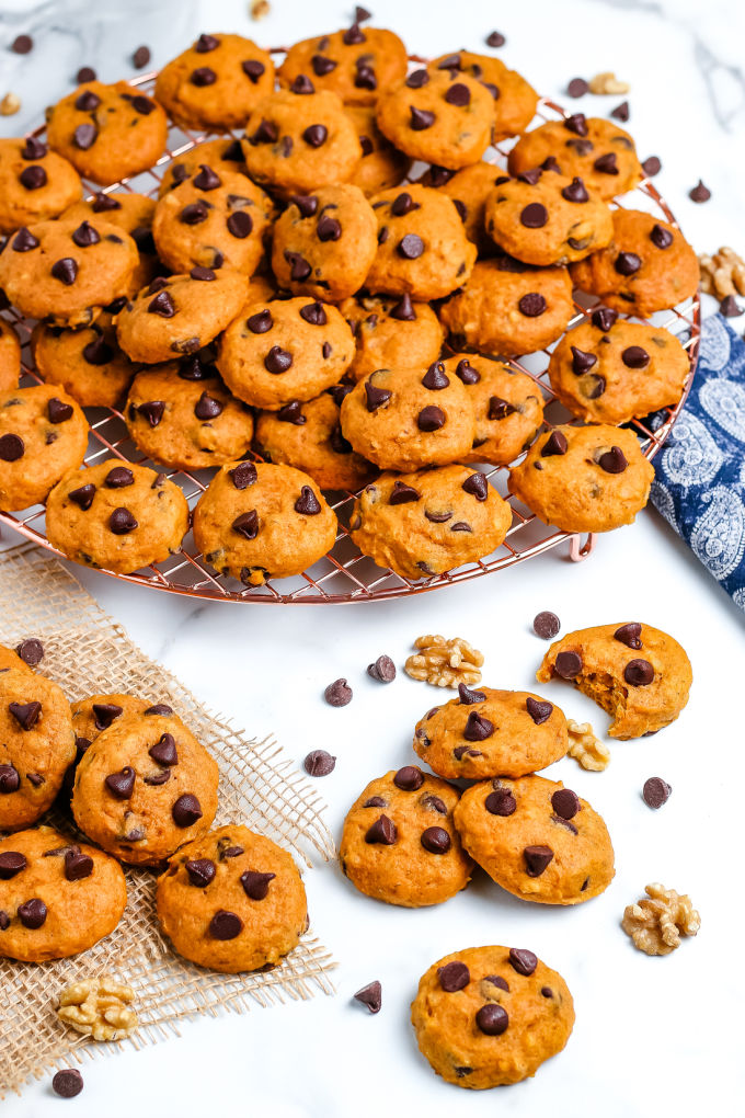 Soft Pumpkin Chocolate Chip Cookies stacked on a wire rack.