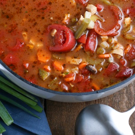 An overhead picture of the finished Chicken Vegetable Soup recipe in a soup pot.