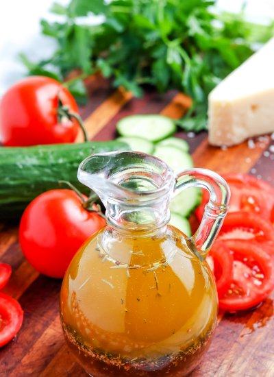 Homemade Italian Dressing in a glass serving bottle.