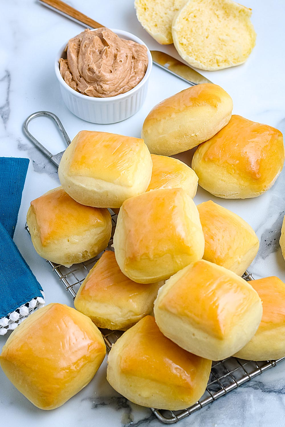 An overhead picture of the finished Copycat Texas Roadhouse Rolls with some cinnamon honey butter.