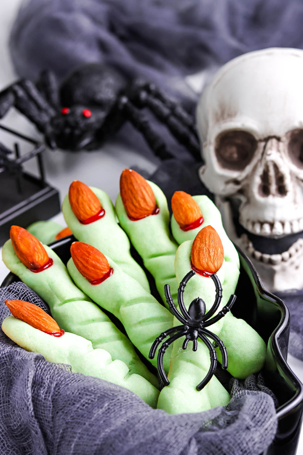A close up picture of the finished Witch Finger Cookies in a serving bowl.