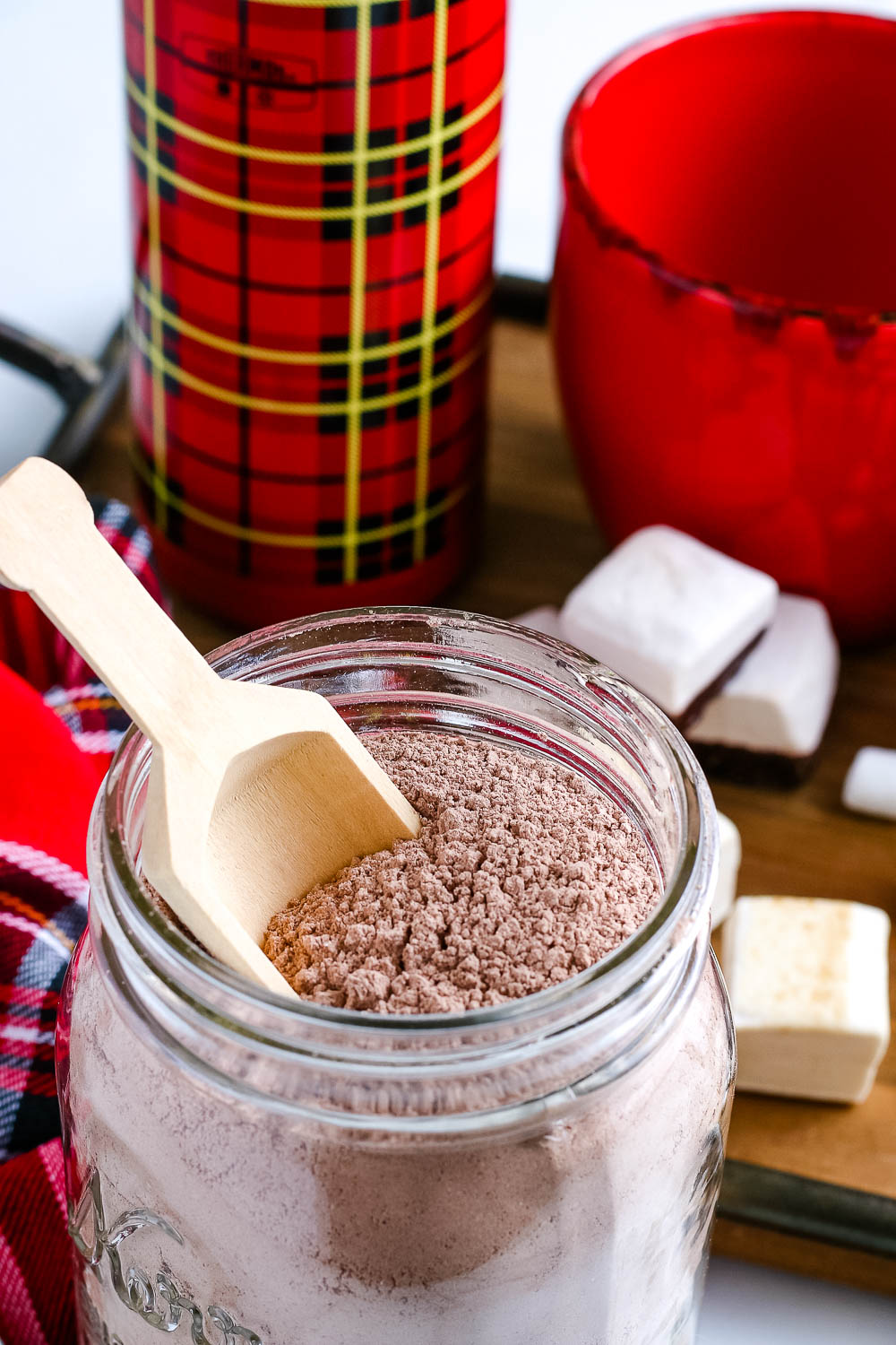 A close up picture of the finished DIY Hot Chocolate Mix Gift in a glass jar.