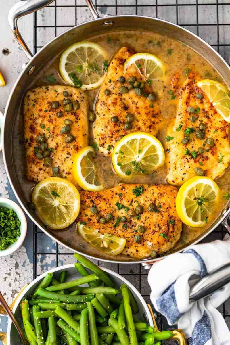 Overhead shot of Easy Chicken Piccata in skillet with lemon white wine sauce