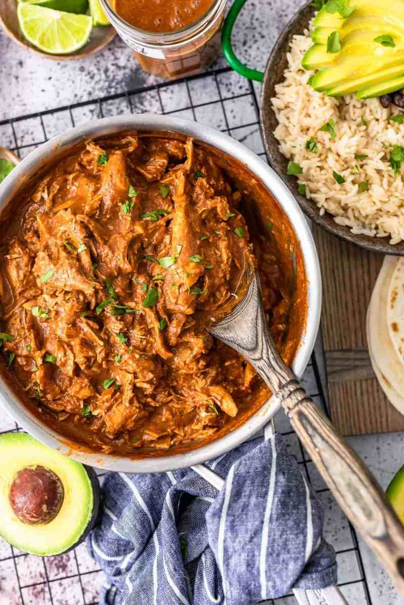 easy chicken mole in a saucepan with rice and avocado