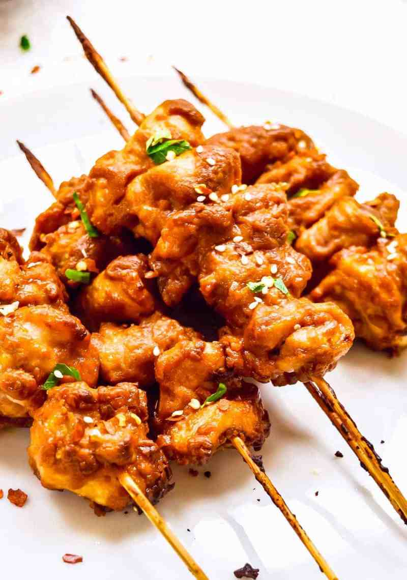 up close stacked chicken satay skewers