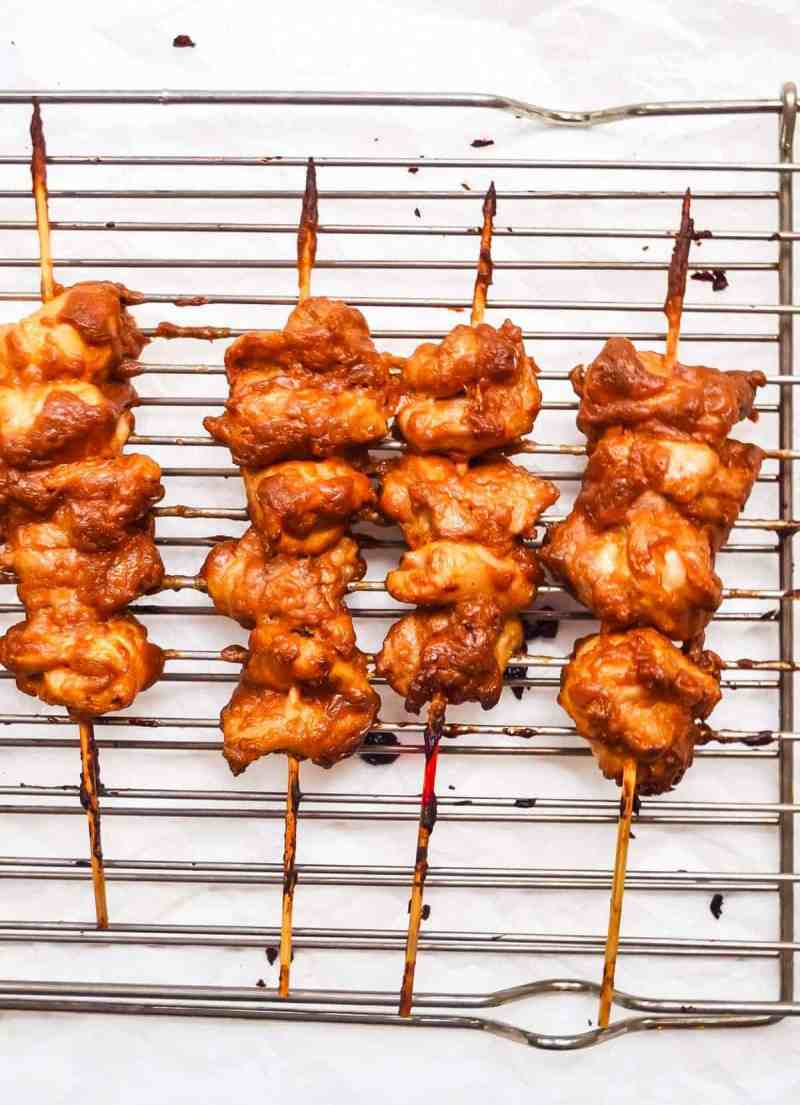 grilling chicken satay skewers