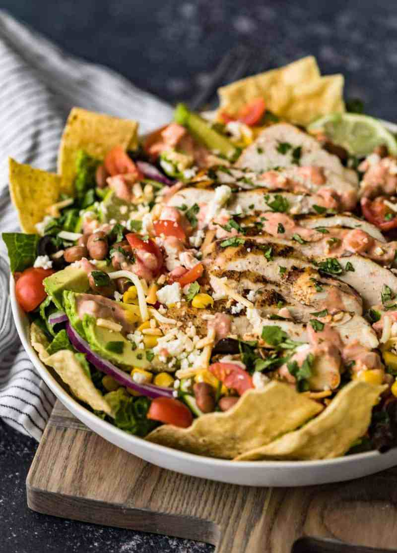 Chicken taco salad served in a large white bowl